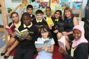 Executive head Patricia Davies with keen young readers at Chingford Hall Primary Academy