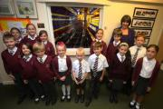 Headteacher Linda Wiskin with some pupils gather around