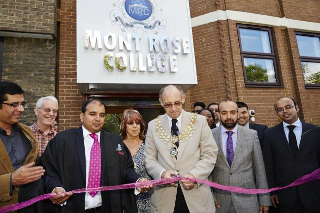 Mayor of Redbridge, Ashley Kissin, cutting the ribbon with Bilal Sheikh, Principal of Mont Rose College, to his left.