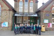 Pupils outside of Woodford Green Primary School in Sunset Avenue