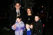 Mayor of Redbridge Cllr Ashley Kissin with his family in front of the Christmas tree.