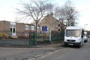 Mini buses outside Joseph Clarke School