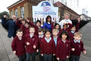 Pupils, Head teacher Misbah Mann, Dean Gibson Parents Support Advisor and Lady Tracey Adebowale-Jones Chair of Governors, celebrate Aldersbrook Primary School's move from 'requires improvement' to 'outstanding' in an Ofsted inspection out this week.