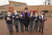 Headteacher Wendy Thomas with pupils celebrating the outstanding judgement by Ofsted at Churchfields Junior School