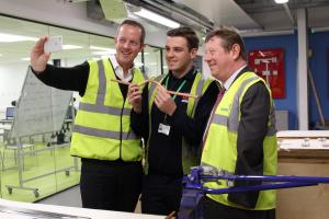 Minister gets lesson in plumbing from young apprentice
