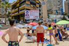 Anthony Dennis' face is broadcast to holidaymakers in Benidorm's Playa Levante (Photo by Brian Hickey/Solarpix.com)