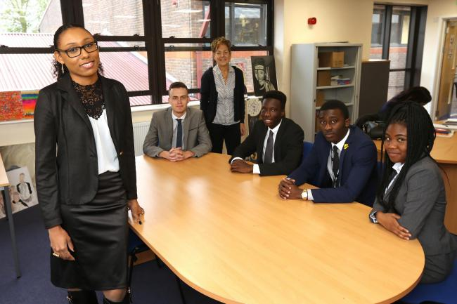 Dr Patrice Baptiste (left) back at her old school the Holy Family Catholic School and Sixth Form in Walthamstow for a career talk with students. (22/10/2015) EL85907_2 (43890611)