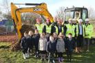 Children, staff and contractors witness the start of building work at St Andrew's CoE Primary School in North Weald, with head teacher Julie Lorkins digging the first hole using an excavator