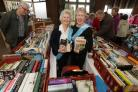 Ann Jones and Brenda Chopping on the book stall during the Alzheimer's Society fundraising morning at West Essex Golf Club, in Bury road, Chingford.