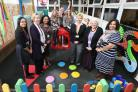 Cabinet member for children and young people, Councillor Elaine Norman with staff at a Woodford Green children's centre.