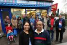 Mr and Mrs Patel and regular customers outside Hitesh News, in Pretoria Avenue, Walthamstow.