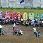 East London and West Essex Guardian Series: Glastonbury Festival hilltop EU flashmob undeterred by mud and rain