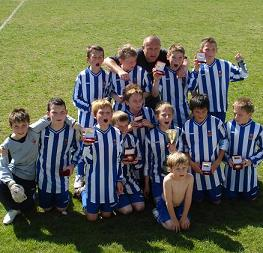 Ongar Juniors celebrate after a hard-fought 1-0 victory over Chelmsford Youth in the final of the Under-12 Cup final (c)