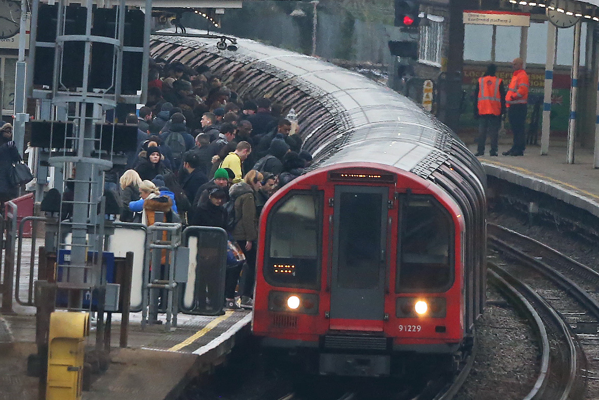 Commuters are facing long queues this evening as the Piccadilly line is suspended and other lines experience delays.