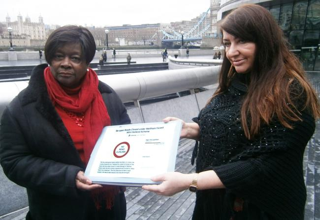 A member of Waltham Forest Streets for All presents the petition to Jennette Arnold.