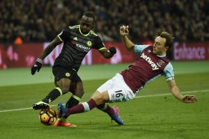 Mark Noble challenges Victor Moses during Monday's defeat. Picture: Action Images