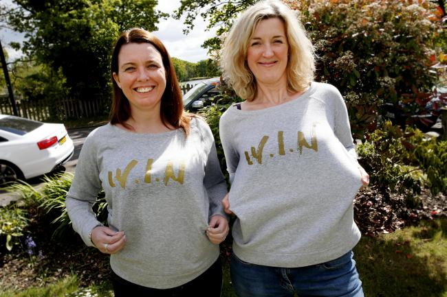 Christina Harvey and Georgie Chambury Burke from Wanstead are selling sweatshirts to raise money for vulnerable women across east London