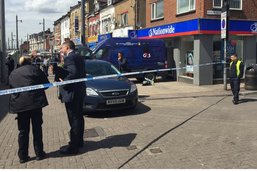Police have taped off Nationwide in Walthamstow High Street