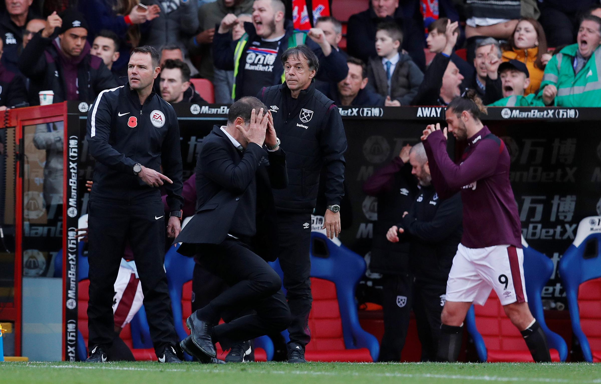 Head in hands: Slaven Bilic reacts to Crystal Palace's injury-time equaliser. Picture: Action Images