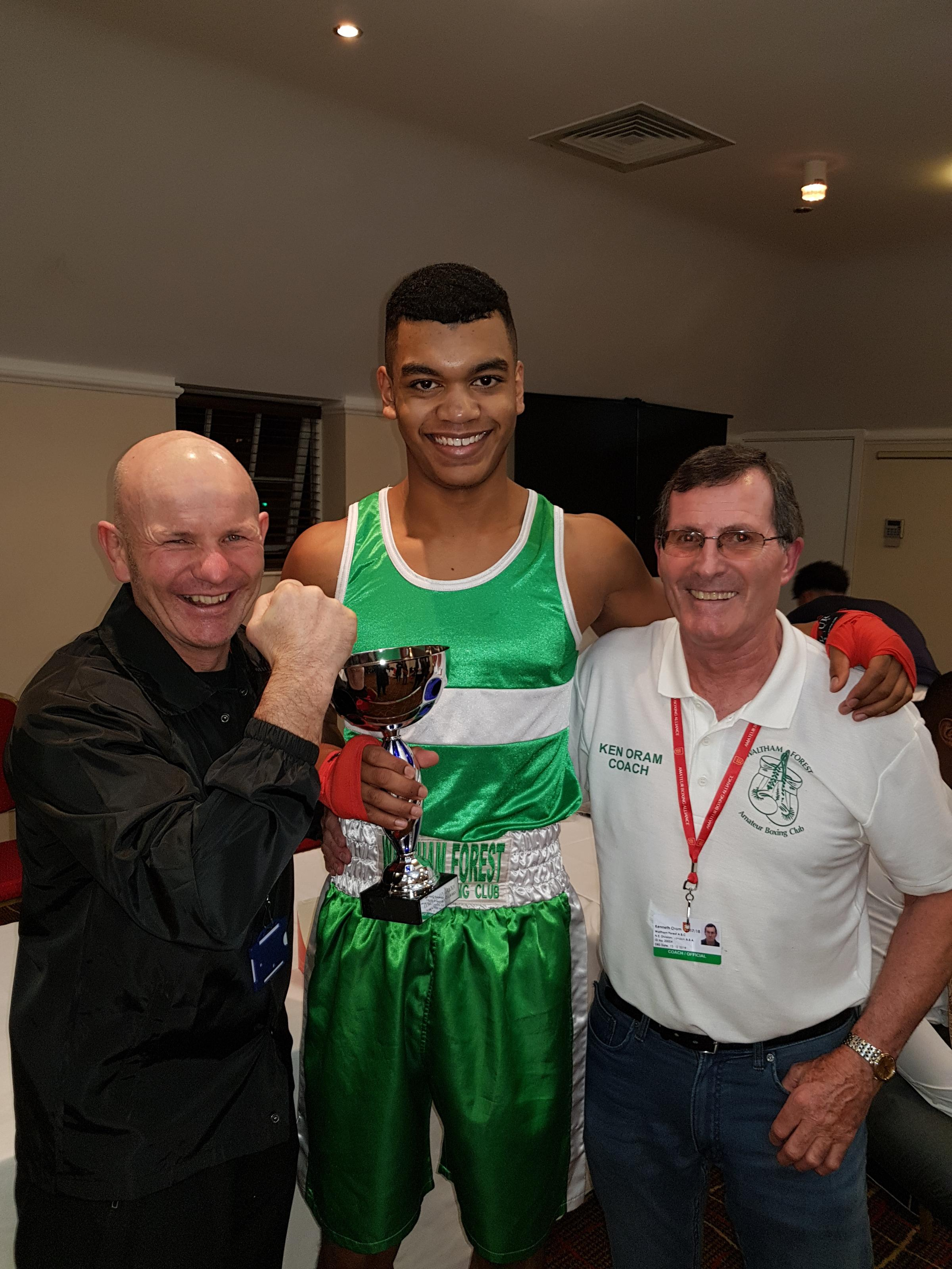 PLEASED-AS-PUNCH: A delighted Cameron Bacchus with coaches Chris Baker (left) and Ken Oram (right).