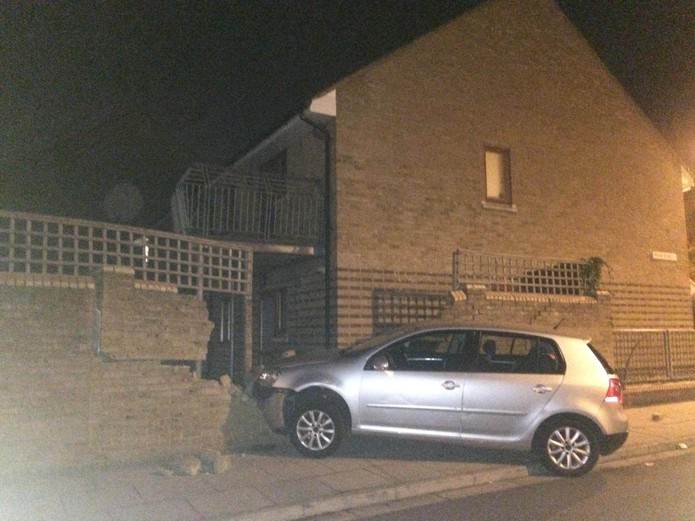 Driver flees after crashing car into wall