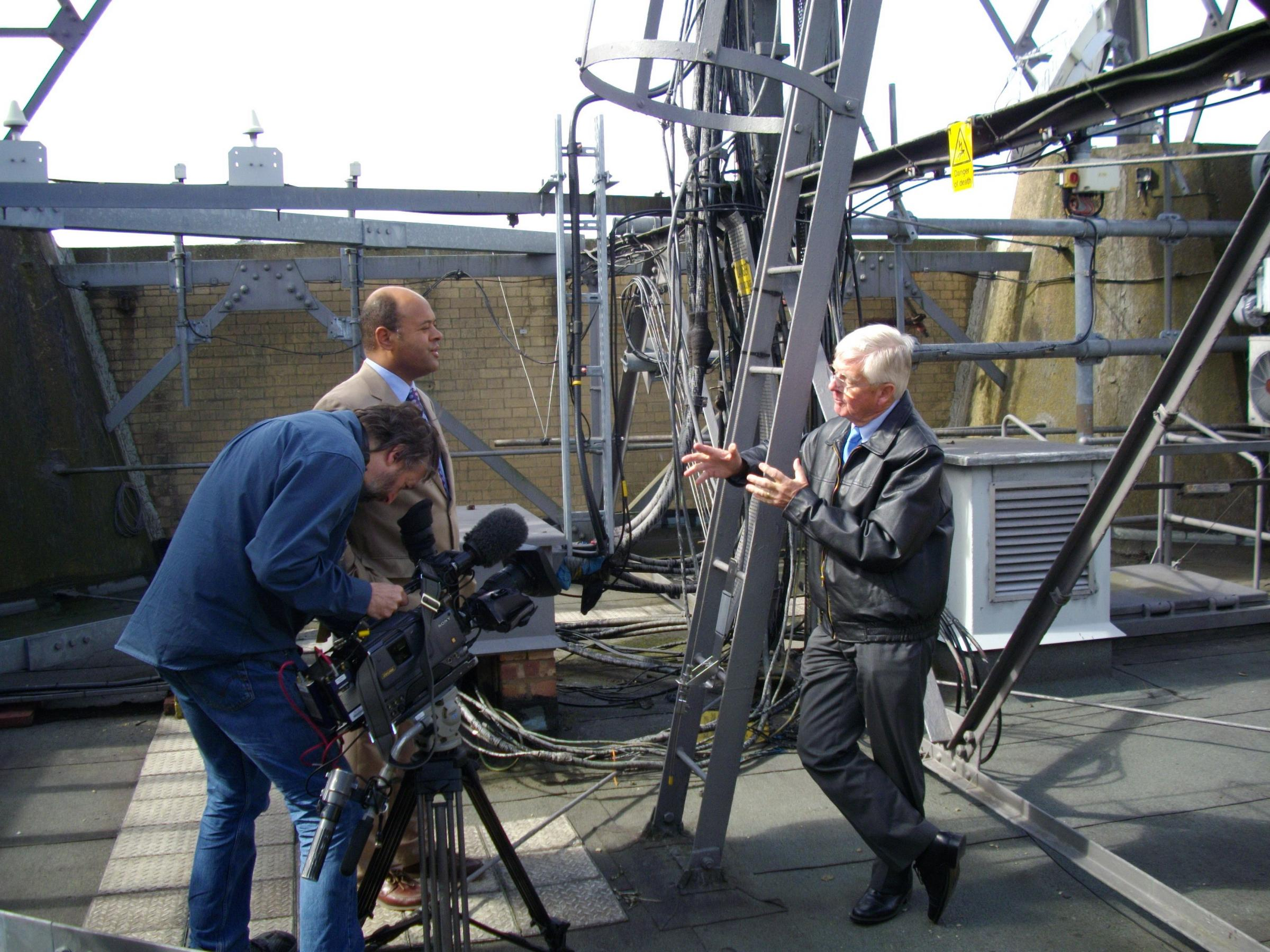 Dr Jim Lewis, far right, filming a piece on the roof of Alexandra Palace for BBC TV.