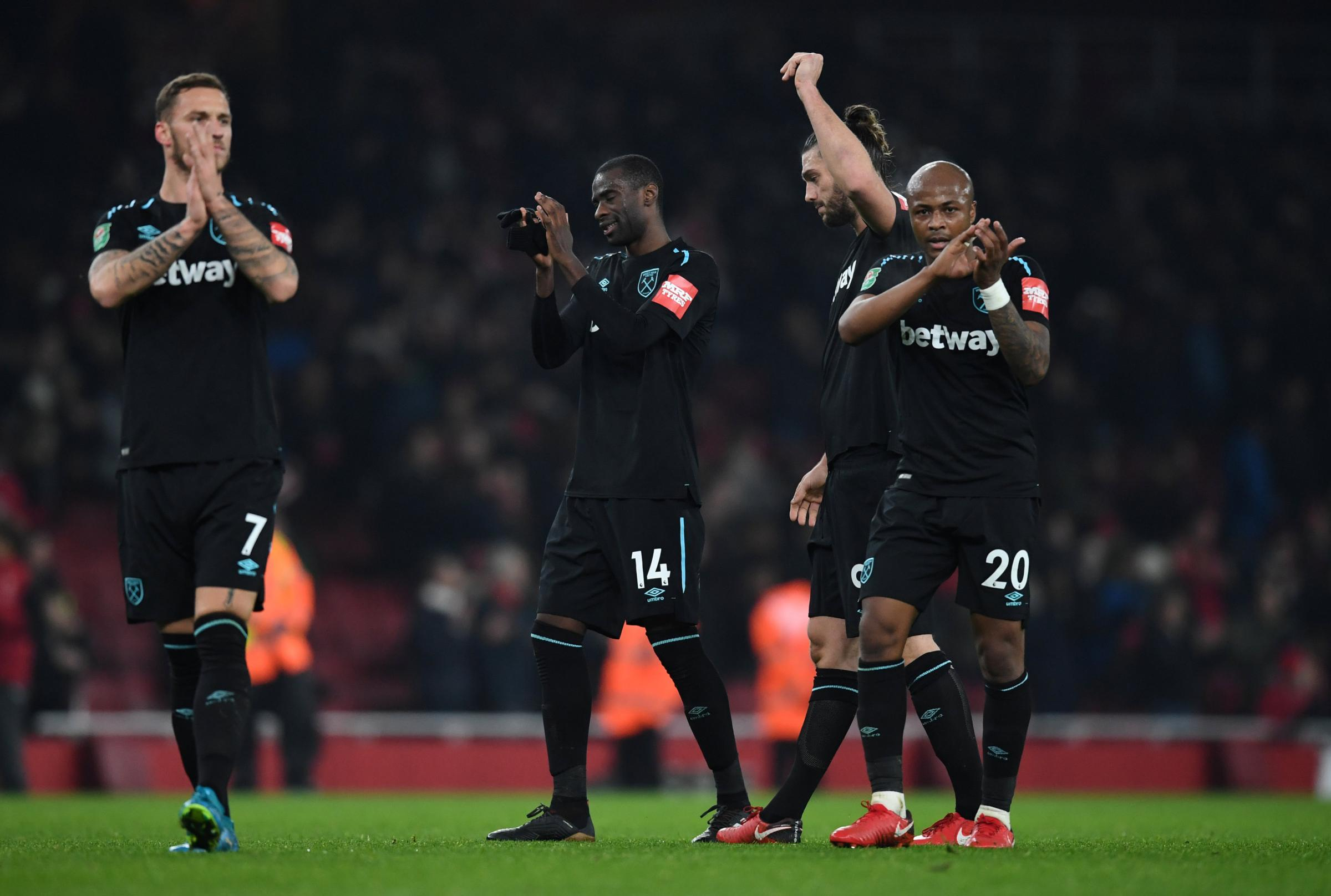 Marko Arnautovic and Andre Ayew applaud their fans following West Ham's exit. Picture: Action Images