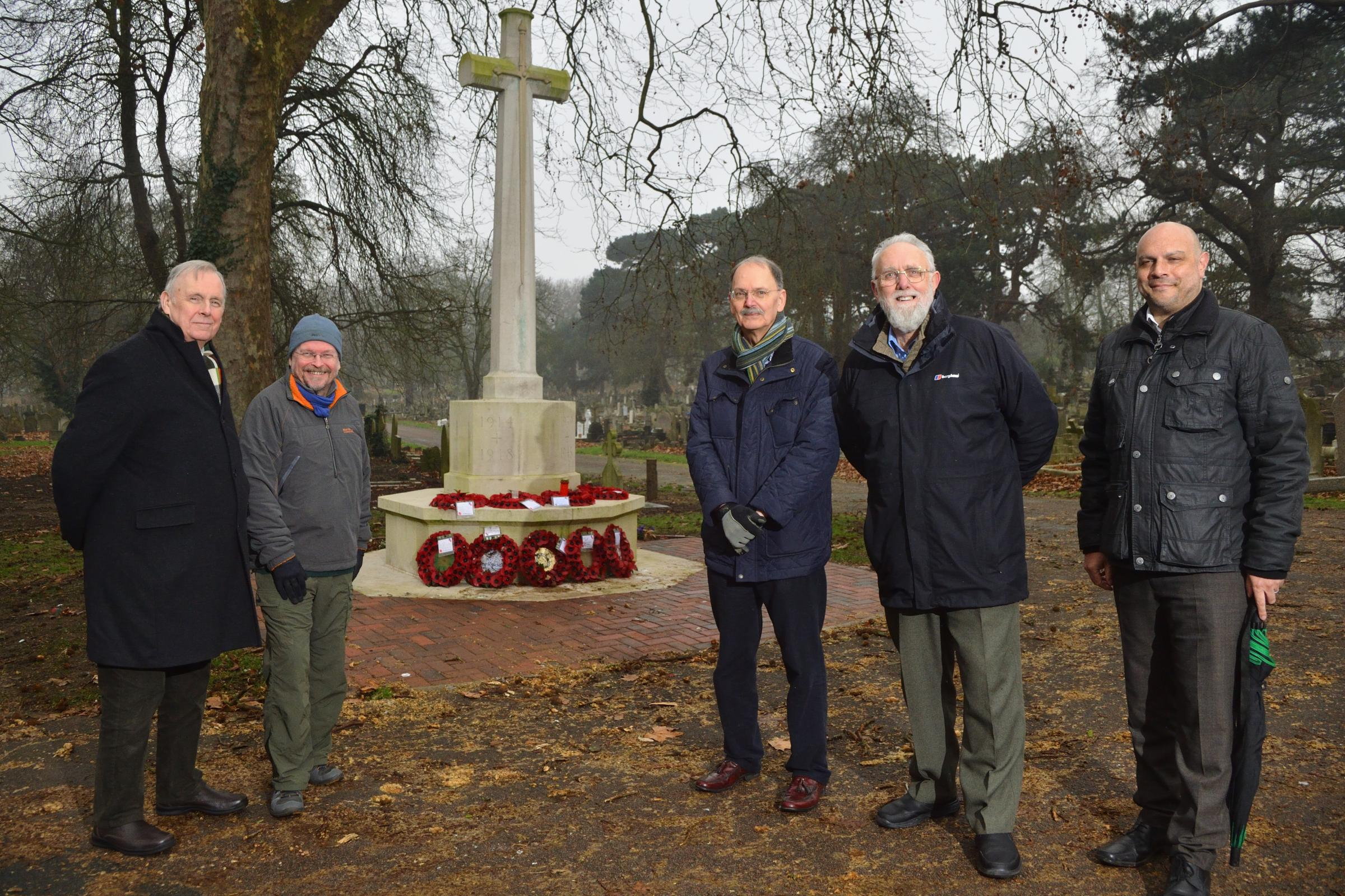 Left to right: Malcolm Doolin, Chris Hunt, Mark Carroll, Roy Berg and Tusar SenGupta at the Cross of Sacrifice in Chingford Mount Cemetery.