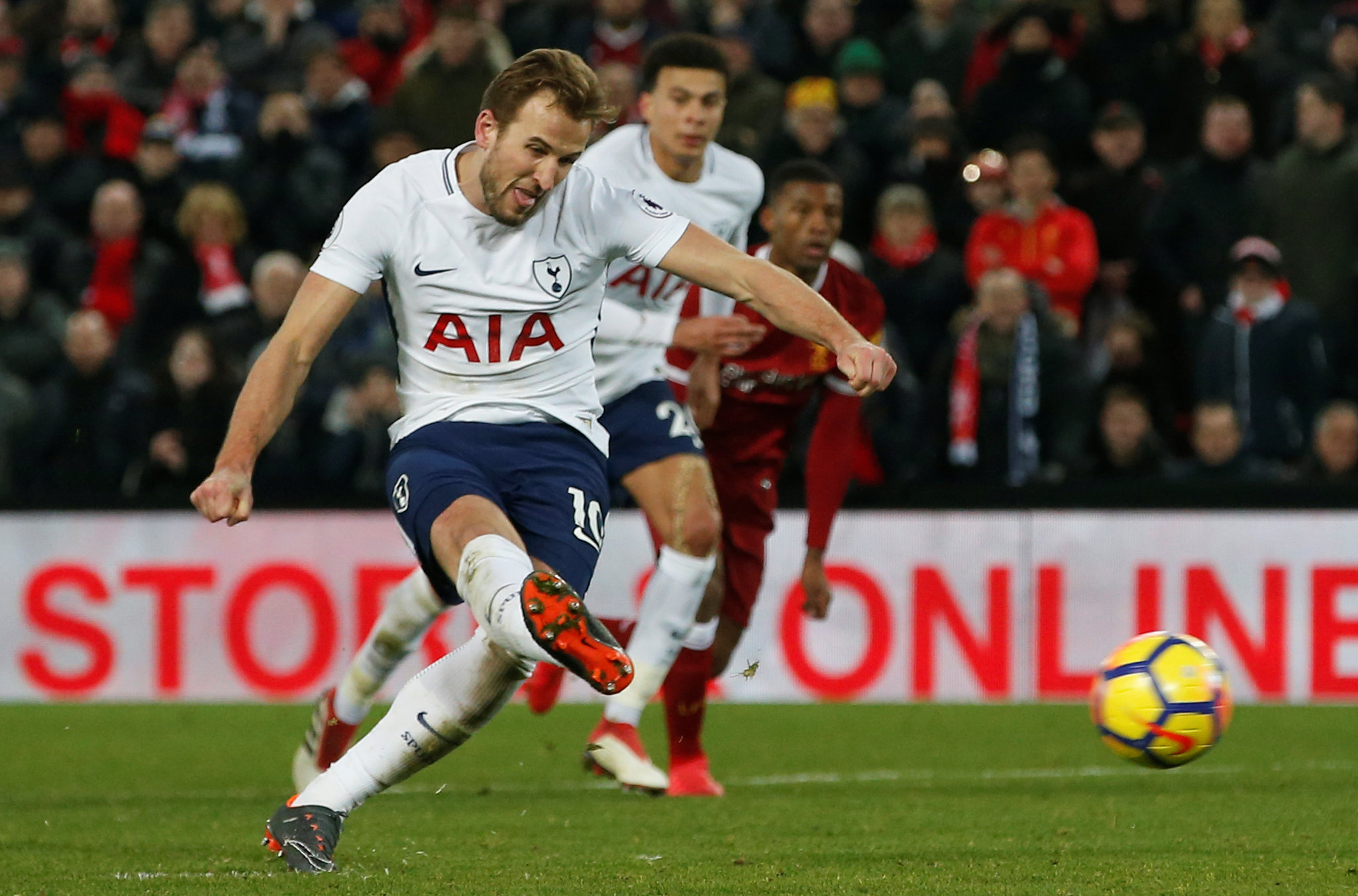 Century up: Harry Kane scores his late penalty to earn Spurs a dramatic draw at Anfield. Picture: Action Images