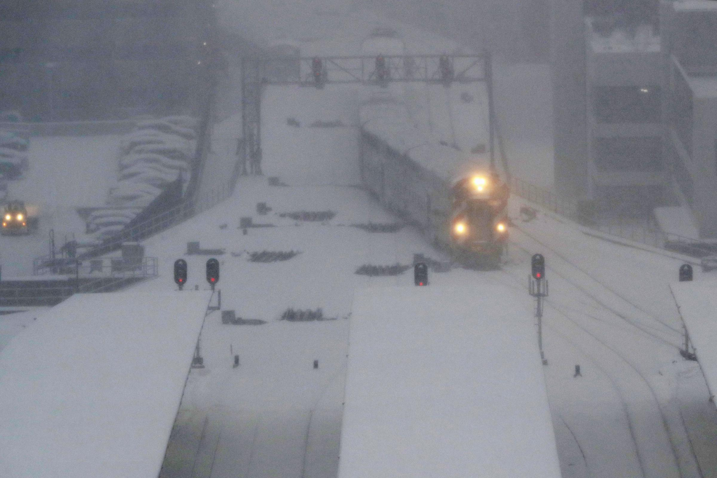 A commuter train pulls into the LaSalle Street station after heavy snowfall (AP)