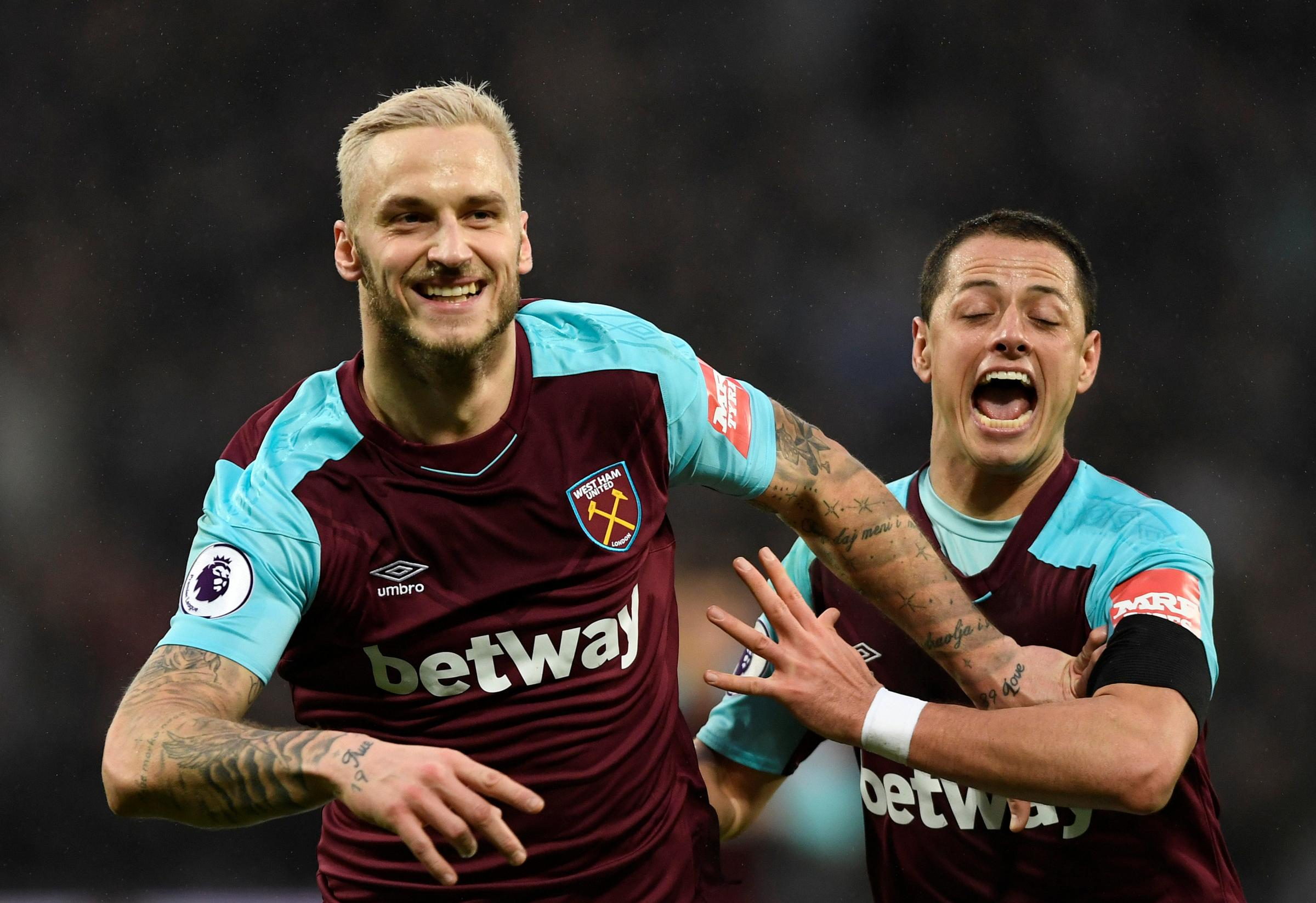 The two scorers celebrate: Marko Arnautovic and Javier Hernandez were both on target in the win. Picture: Action Images