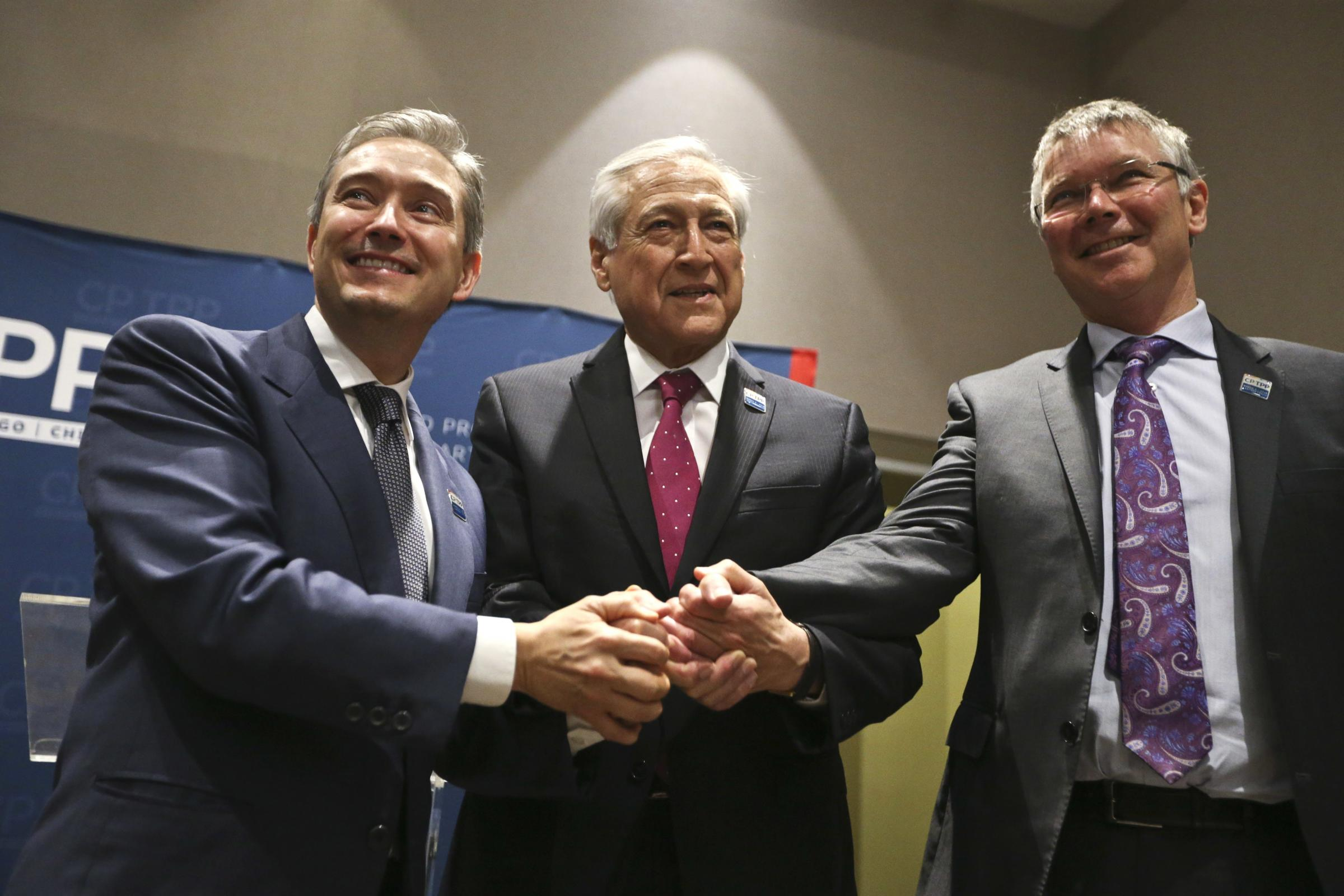 Canada's Minister of International Trade Francois-Philippe Champagne, Chile's Foreign Minister Heraldo Munoz and New Zealand's Trade Minister David Parker pose before the signing of the Comprehensive and Progressive Agreement for Trans-Pacific Partn