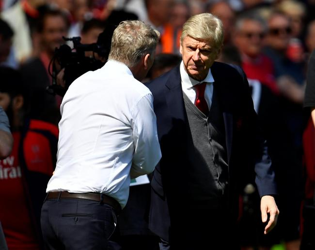 David Moyes shakes hands with Arsene Wenger before the match. Picture: Action Images