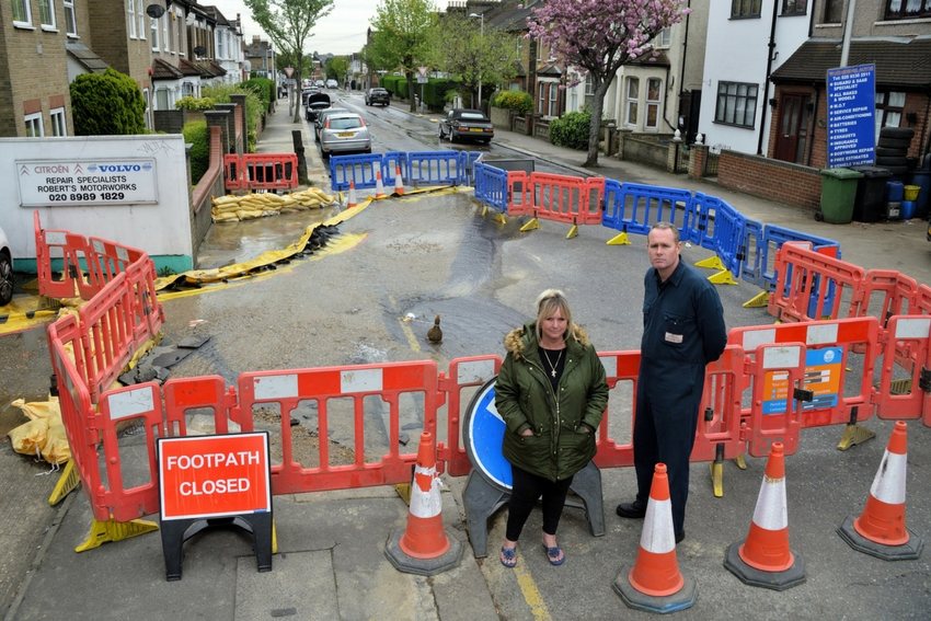 Jackie Burvill, of Woodbridge Autos and Nick Wright, of Roberts Motorworks, say the burst pipe is beginning to affect their businesses