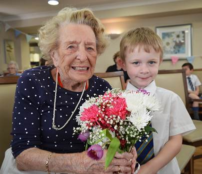 Joan Green with one of her flowery helpers