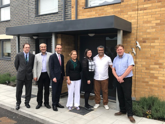 Deputy Mayor of London for housing (third from left) and deputy council leader (far right) visited the family to congratulate them