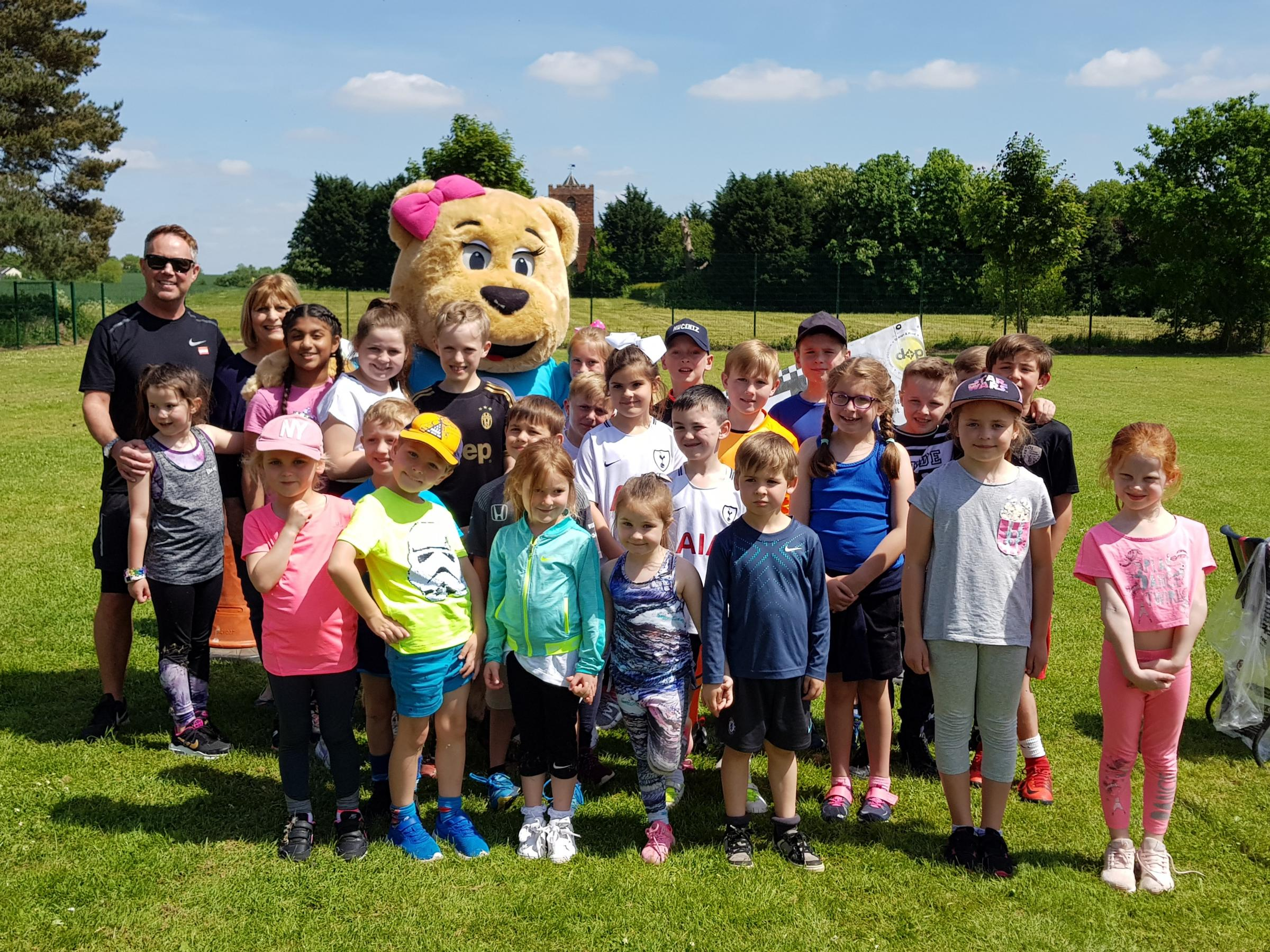 Clare Bear poses with Moreton pupils