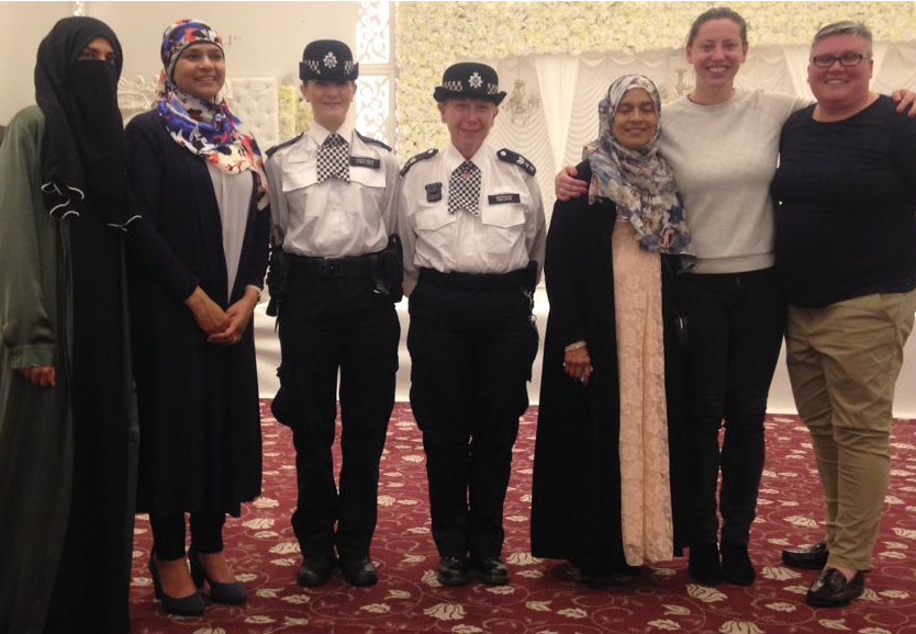 Waltham Forest Council leader Clare Coghill, second from right, with policewomen and guests at the community iftar on Monday.