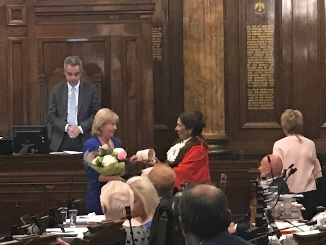 Outgoing mayor Linda Huggett received flowers and an illuminated copy of the council's vote of thanks