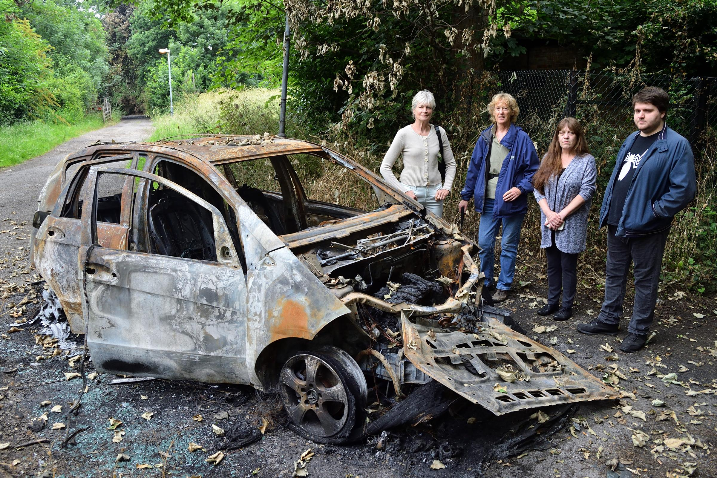 Mother living in fear of yobs who set fire to cars outside her house