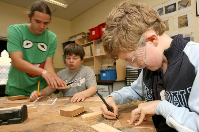 Children take part in a woodwork class at a summer camp run by Waltham Forest Dyslexia Association.