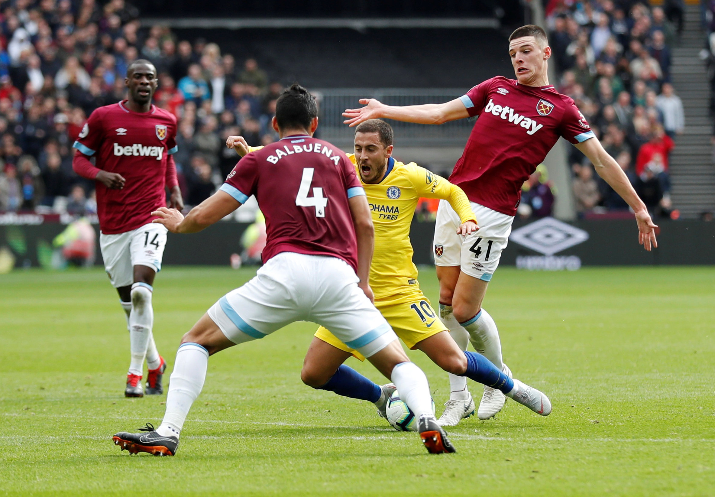 Declan Rice clashes with Eden Hazard. Picture: Action Images