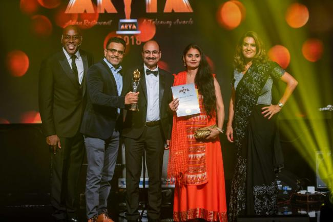 Rajesh beams as he is presented with his ARTA award