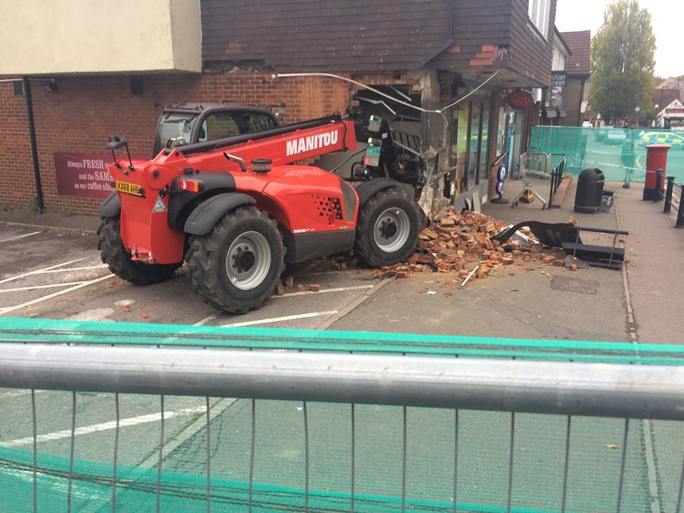 The red Manitou digger crashed into the Theydon Bois Tesco.