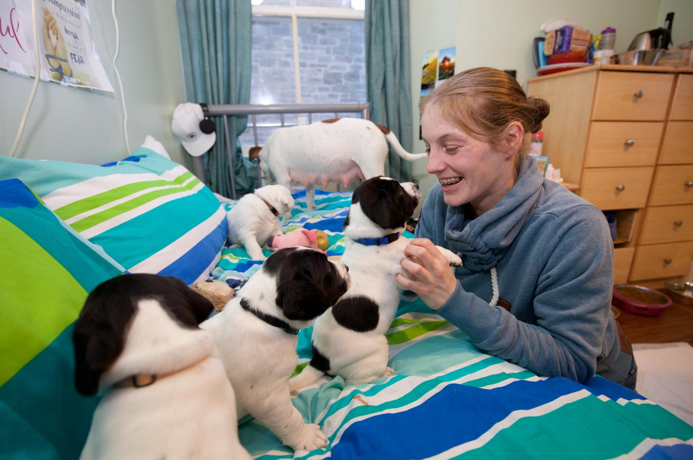 Natasha Robins with puppies
