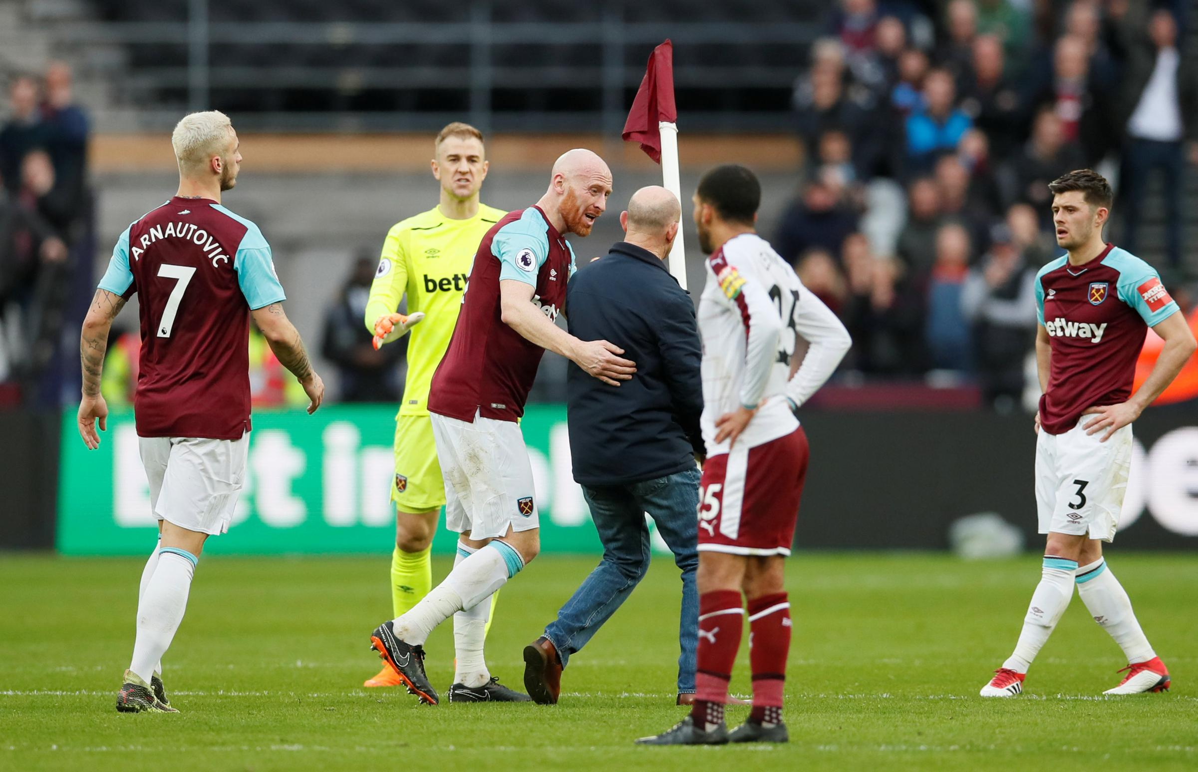 Former West Ham fan James Collins confronts a fan during the trouble. Picture: Action Images