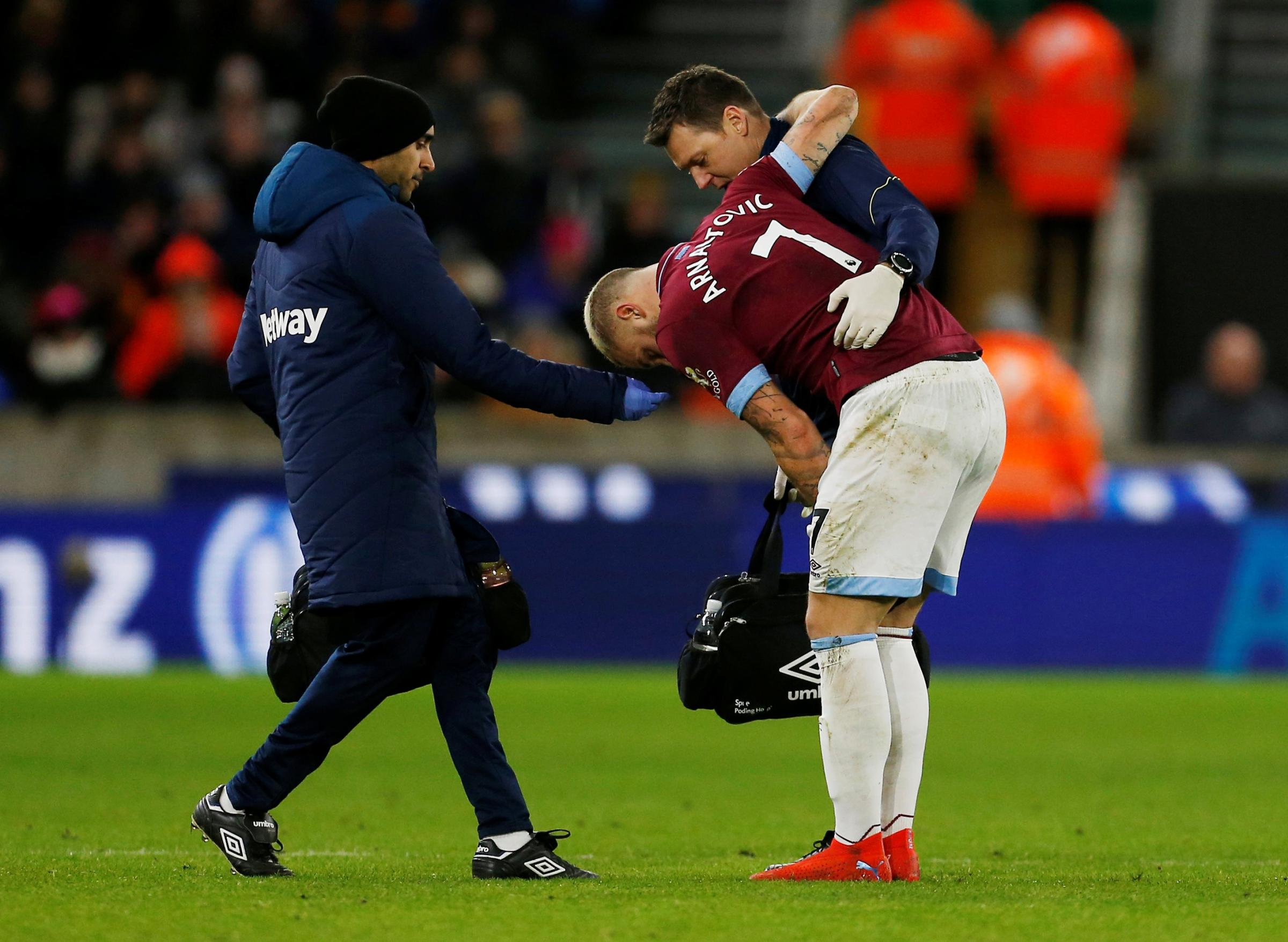 The injured Marko Arnautovic receives treatment. Picture: Action Images