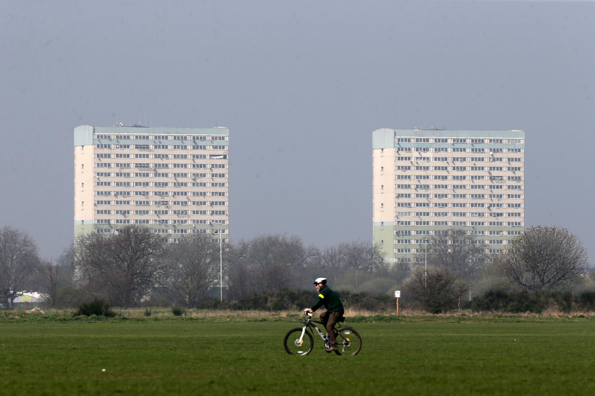 Fred Wigg and John Walsh Towers in Leytonstone seen from Wanstead Flats through the pollution/smog haze.