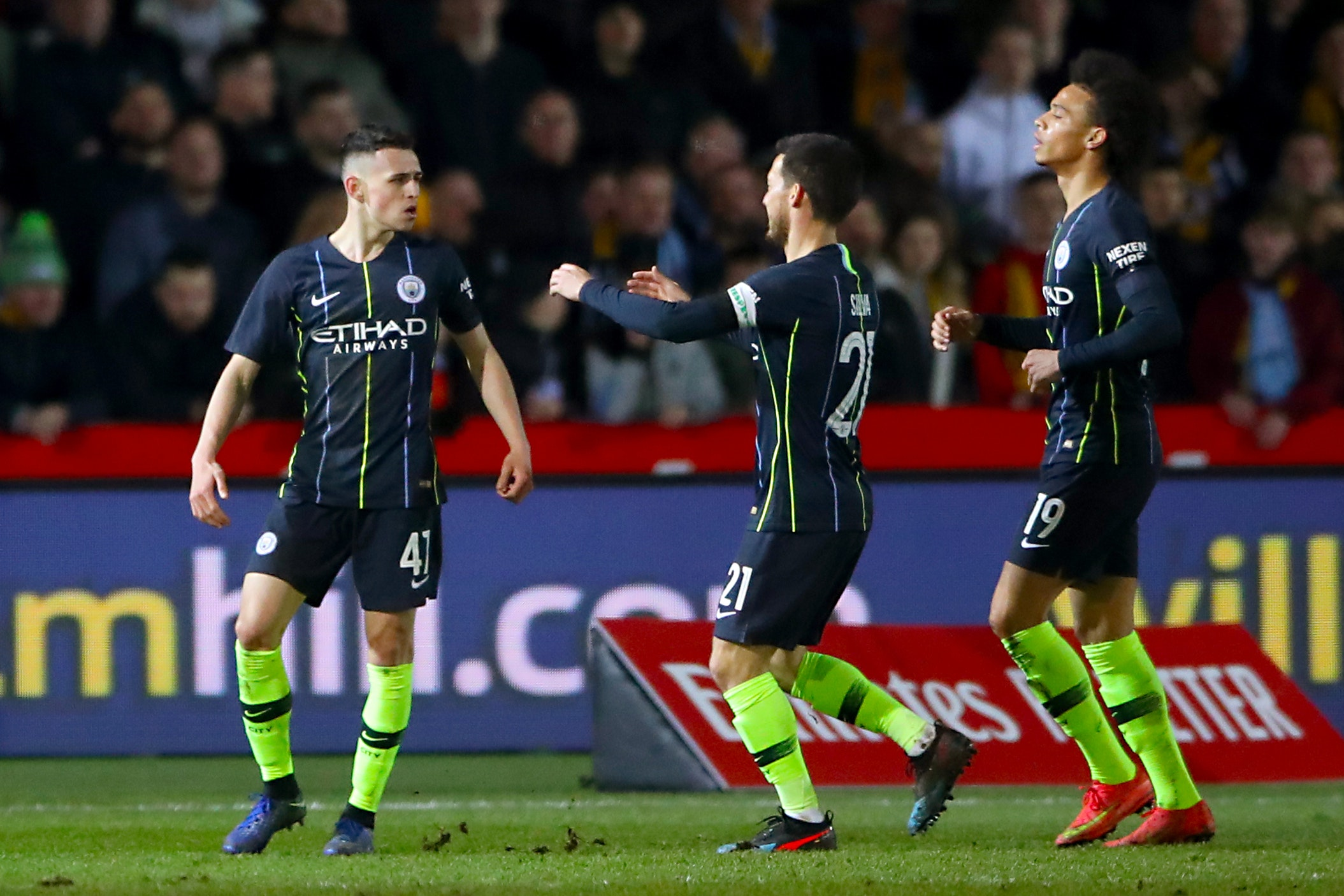 Manchester City's Phil Foden (left) celebrates scoring his side's second goal in their FA Cup win at Newport