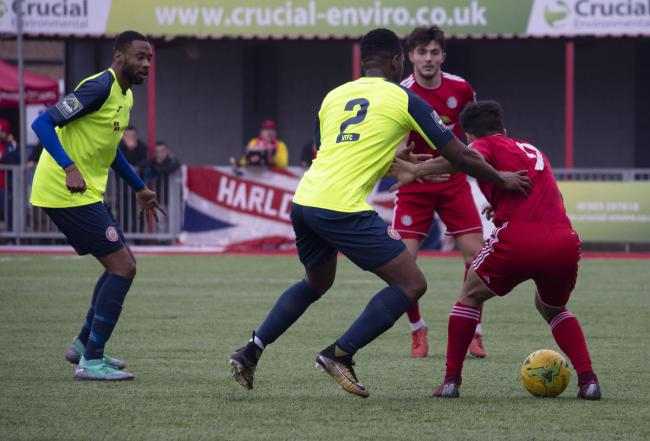 Harlow Town's Emanuel Udoji battles for the ball against Worthing. Picture: Stephanie Webb